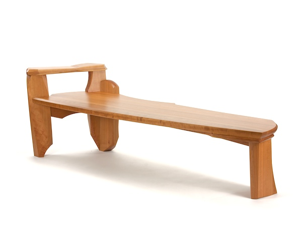 Bench #12- modern wood bench made of cherry with one arm rest and dramatic movement