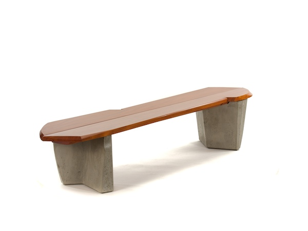 cast concrete and mahogany combined in a sculptural bench