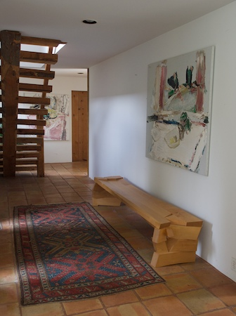 bench 3 in a hallway with rugged stairs