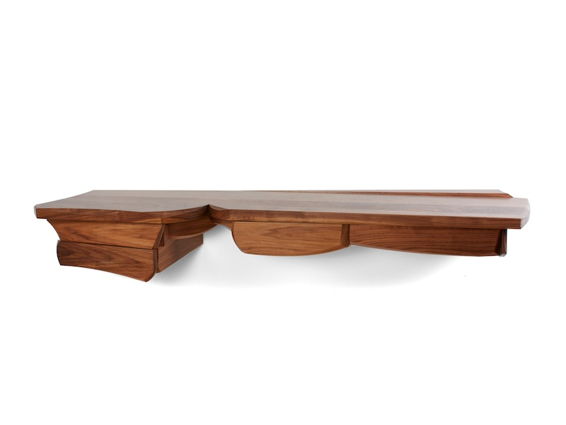 sculptural walnut console with four drawers