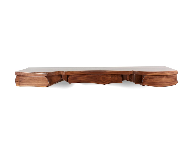 Sculptural wall hung console in walnut with assymetrical composition