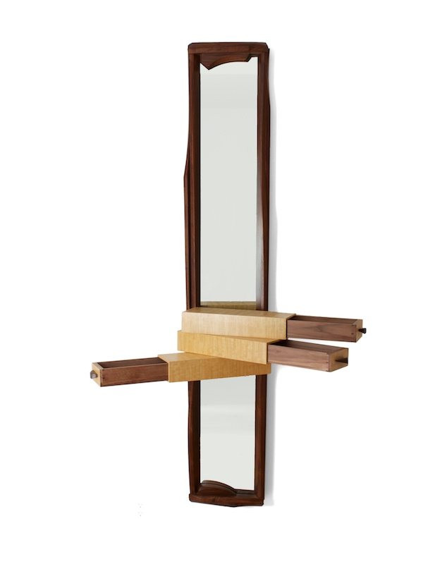 three drawers open on this sculptural mirror