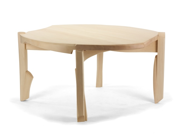 Dining Table #4- Modern Circular Dining Table is a five foot table that undulates from its circular beginings.  The movements relate to the legs that are pulled to the edge and pull up above the surface.