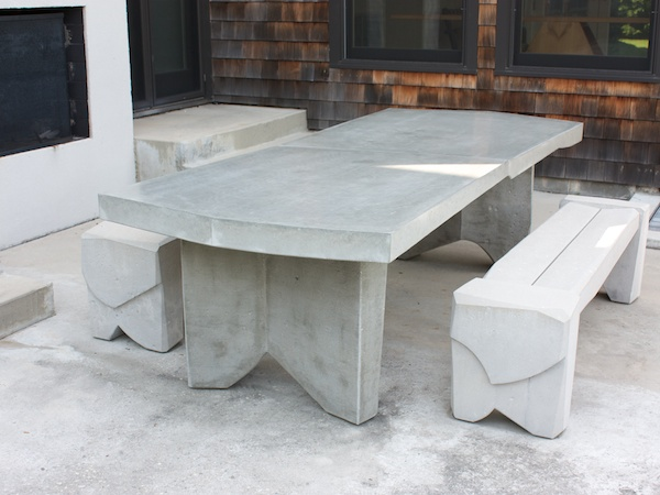 Modern outdoor dining table in cast concrete