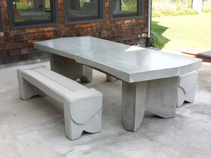 massive concrete dining table with bench